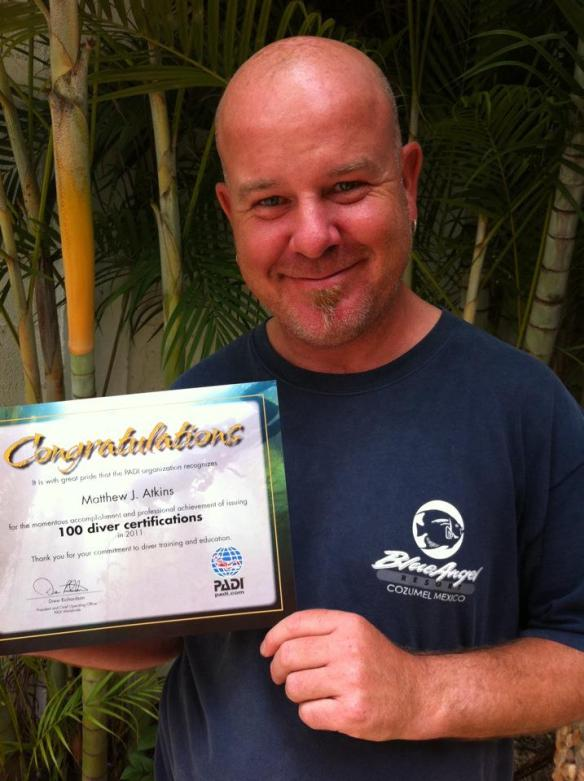 Matthew Atkins, recognized by PADI for issuing 100 certifications during 2011.