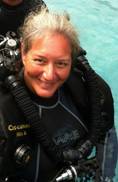 Kari Taylor Atkins trying a rebreather during her IDC Staff Instructor course